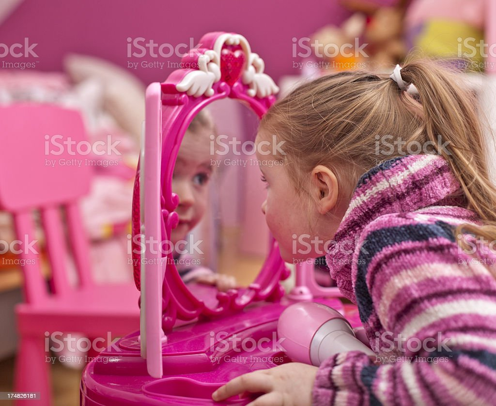 Little girl is playing with her doll royalty-free stock photo