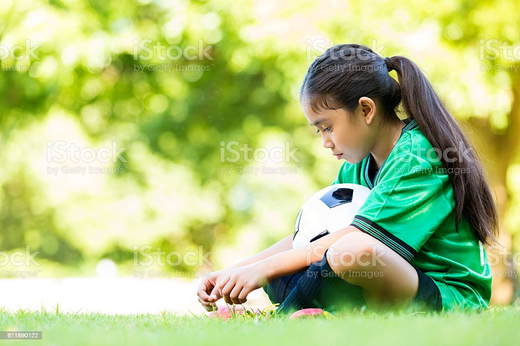 Little girl is sad after losing soccer game stock photo