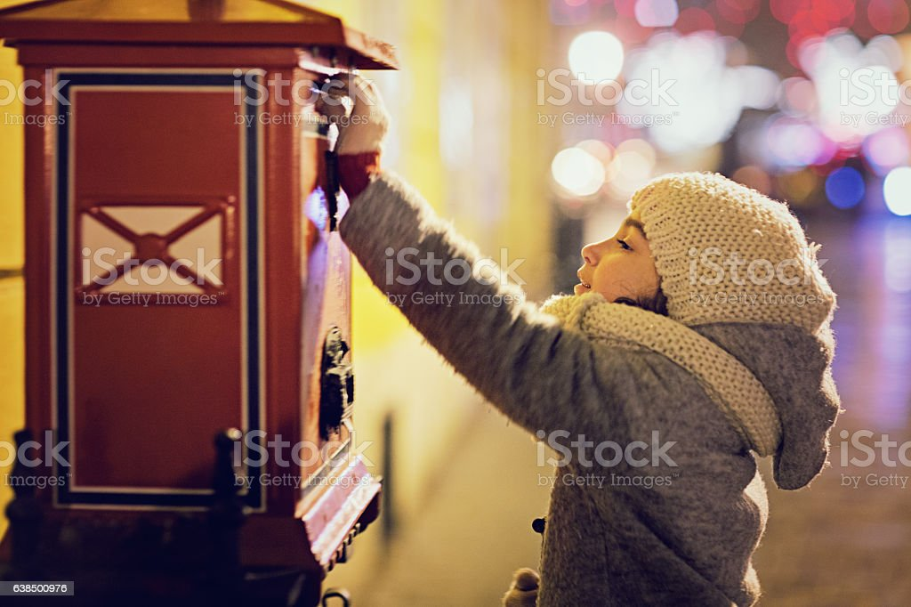 Little girl is sending letter in the night stock photo