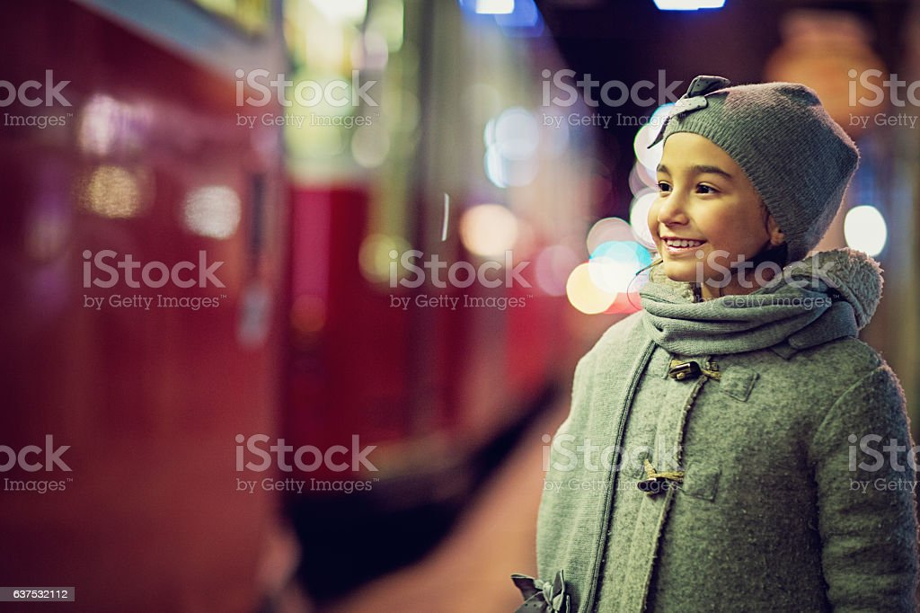 Little girl is standing at the station stock photo