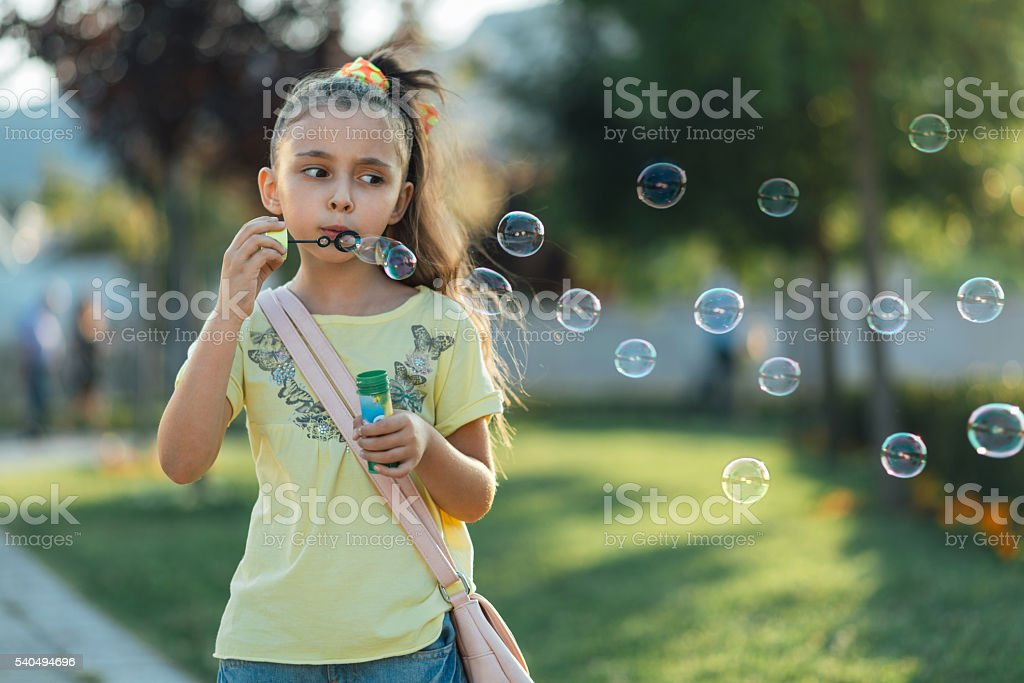 little girl is staying in the park stock photo