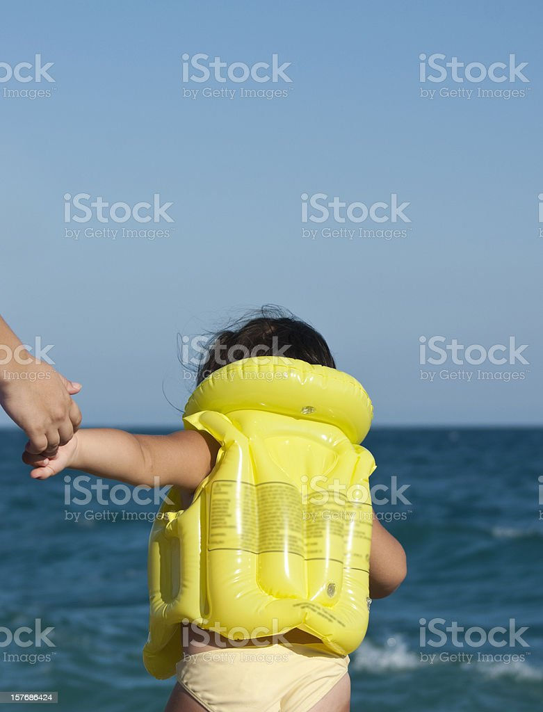 little girl is wearing life jacket royalty-free stock photo