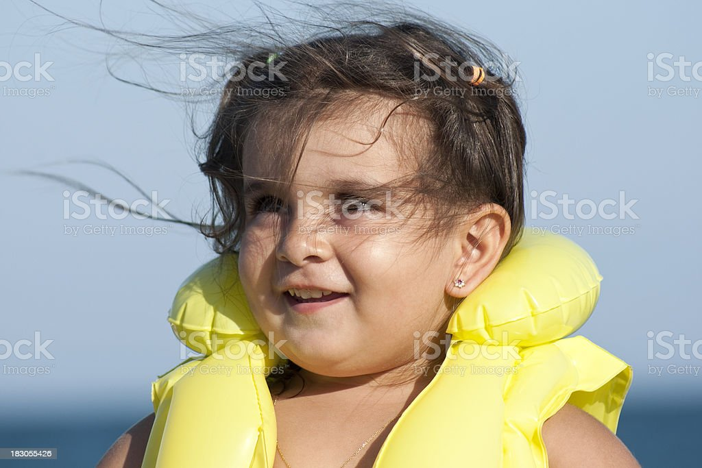 little girl is wearing life jacket royalty-free stock photo