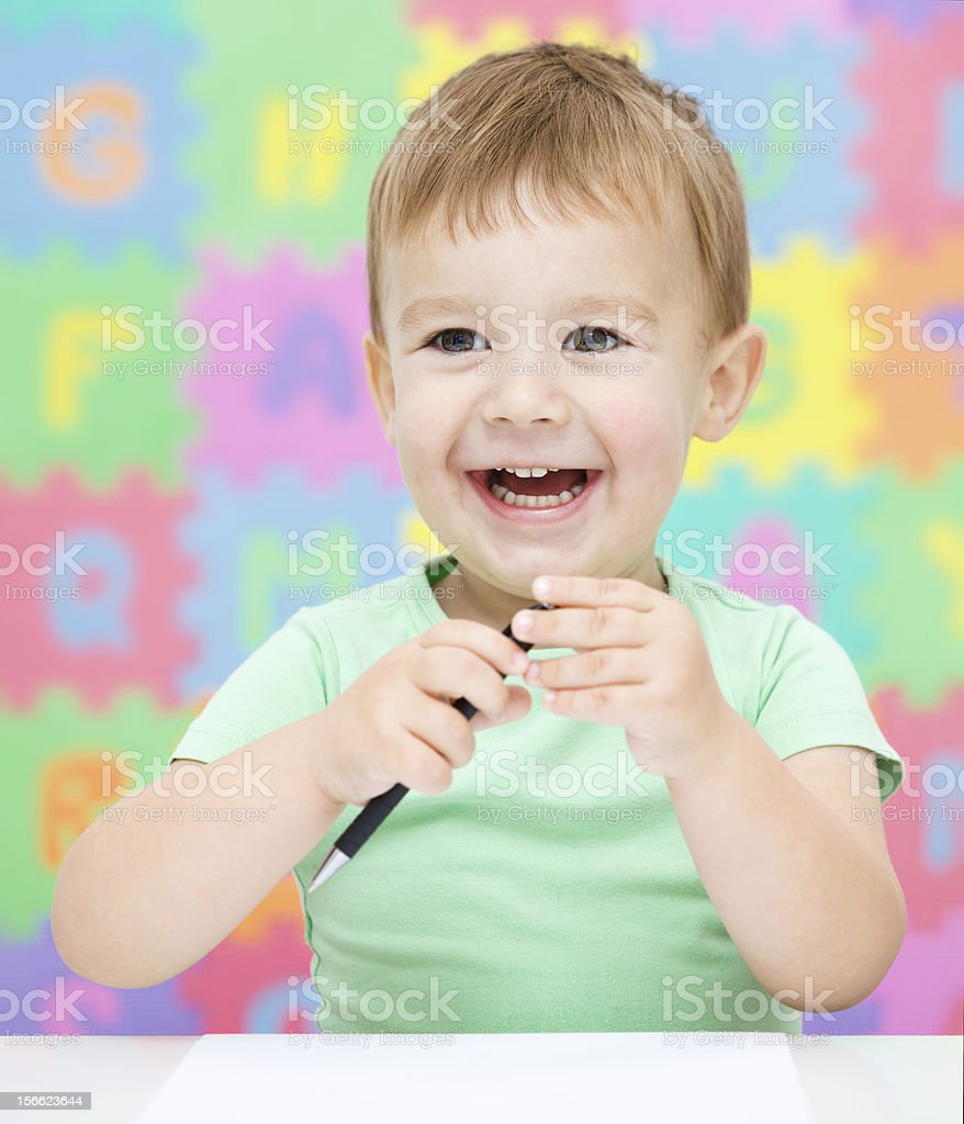 Little girl is writing using a pen royalty-free stock photo