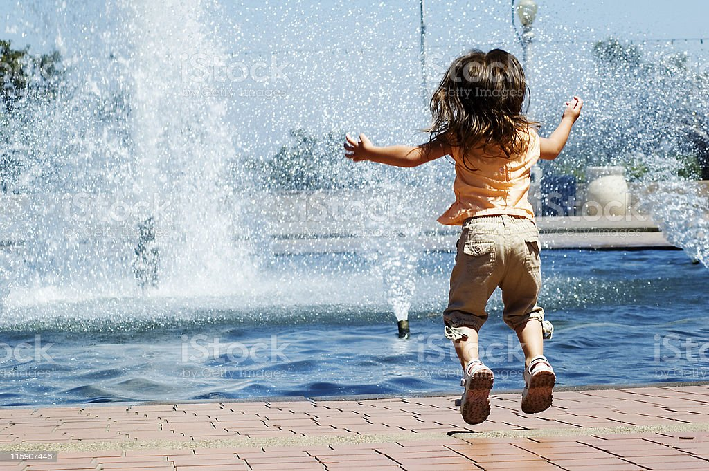 Little girl jumping in exctitement royalty-free stock photo