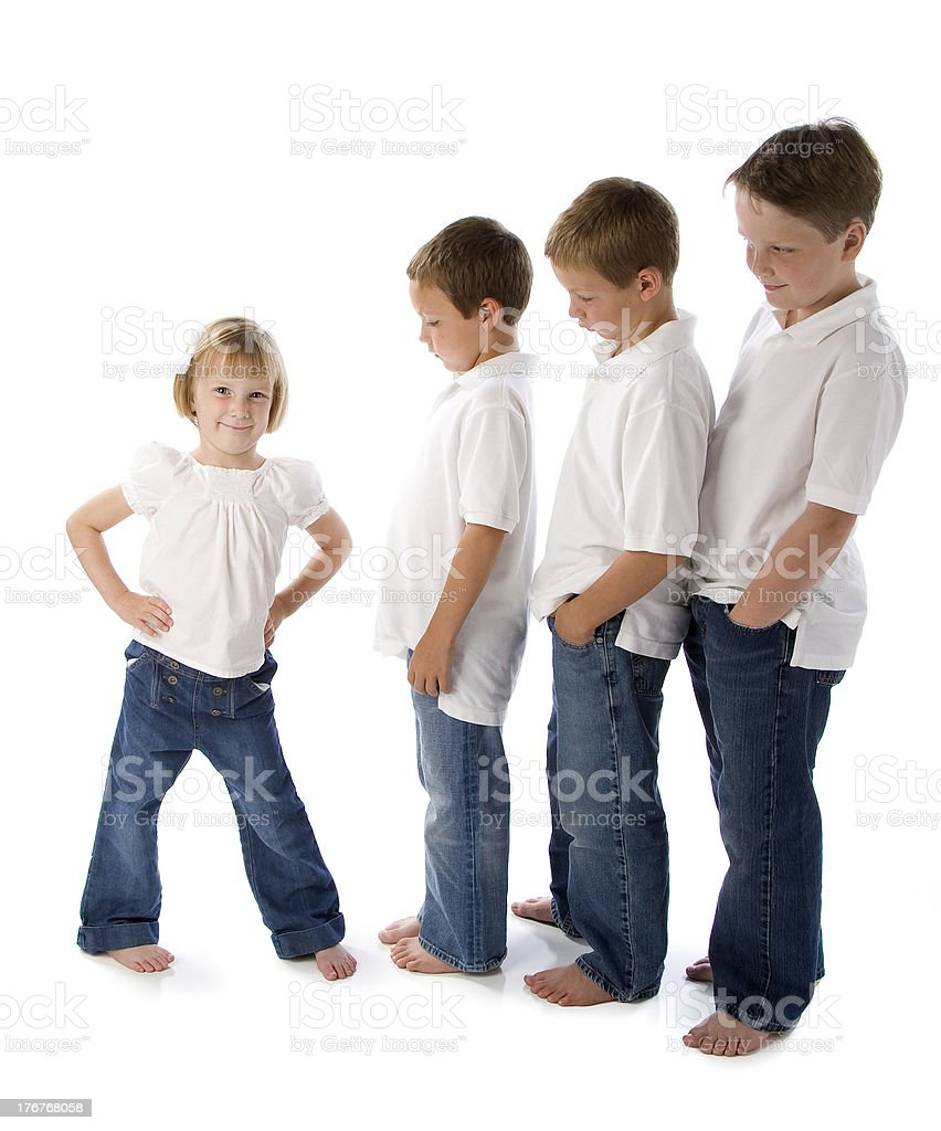 Little Girl Keeps Boys in Line royalty-free stock photo