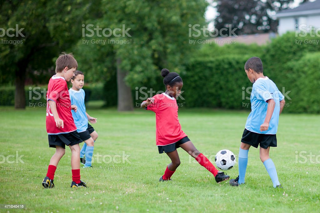 Little Girl Kicking the Ball stock photo