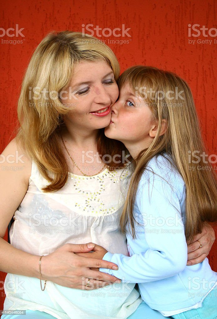 Little girl kissing her mother royalty-free stock photo