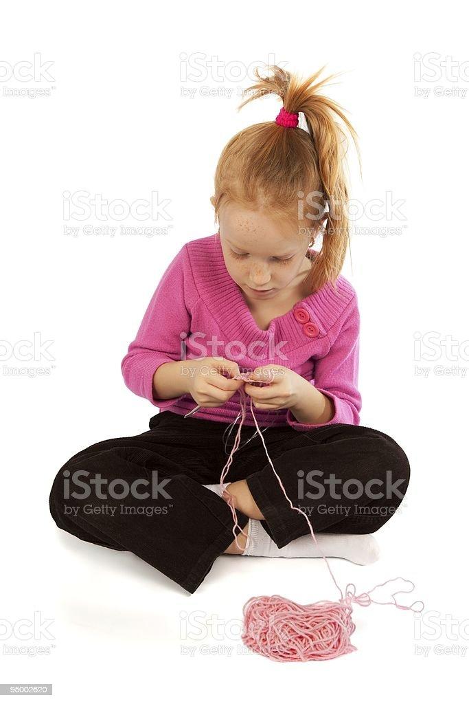Little girl knitting royalty-free stock photo