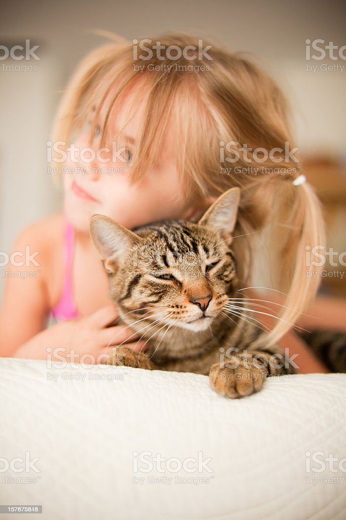 Little Girl Laying with her Cat royalty-free stock photo