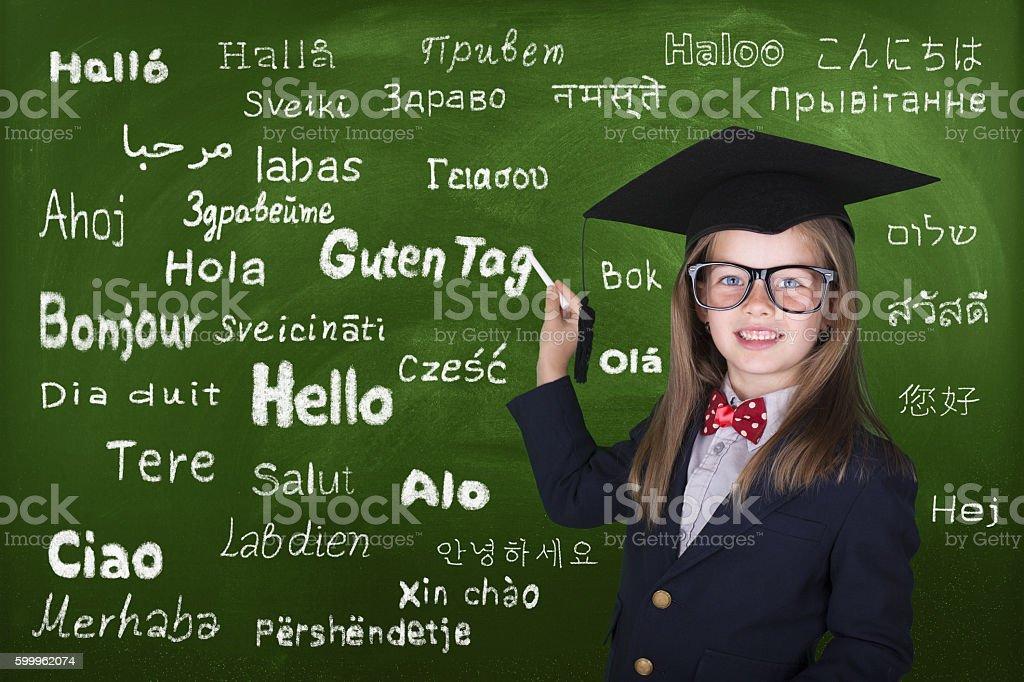 Little girl learn multi language stock photo
