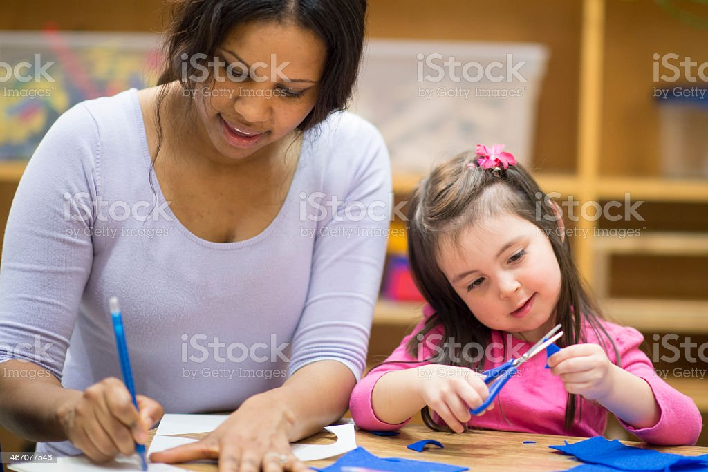 Little Girl Learning Arts and Crafts stock photo