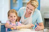 Little Girl Learning How to Bake