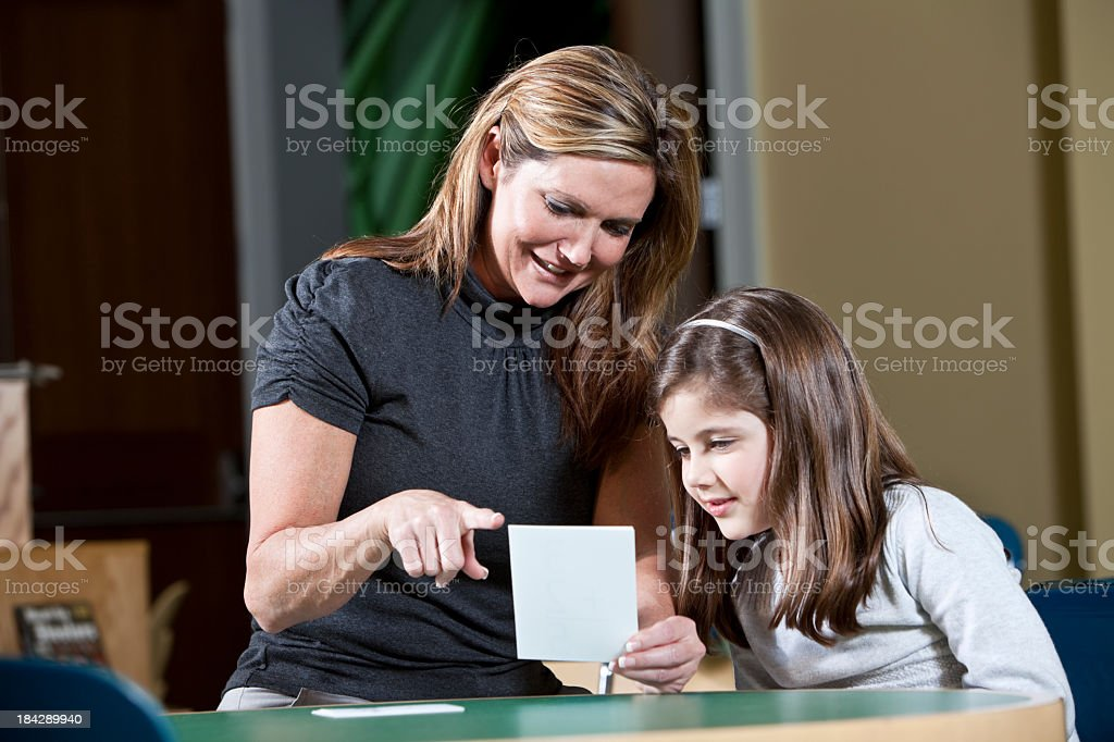Little girl learning stock photo