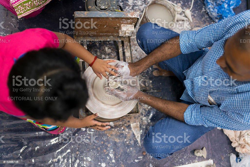 Little Girl Learning Pottery Turning, Singapore stock photo
