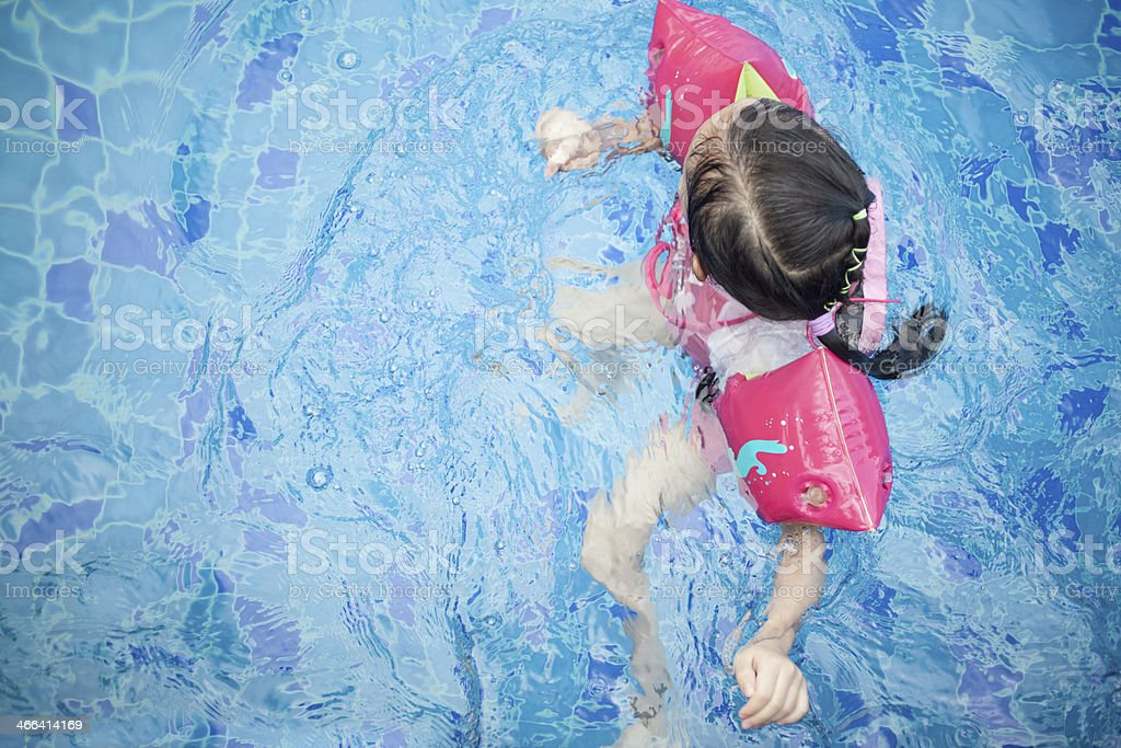 Little Girl Learning Swimming stock photo