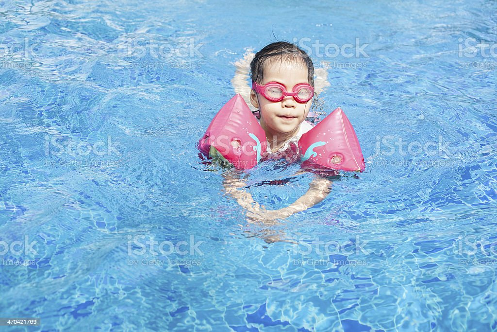 Little Girl Learning Swimming royalty-free stock photo
