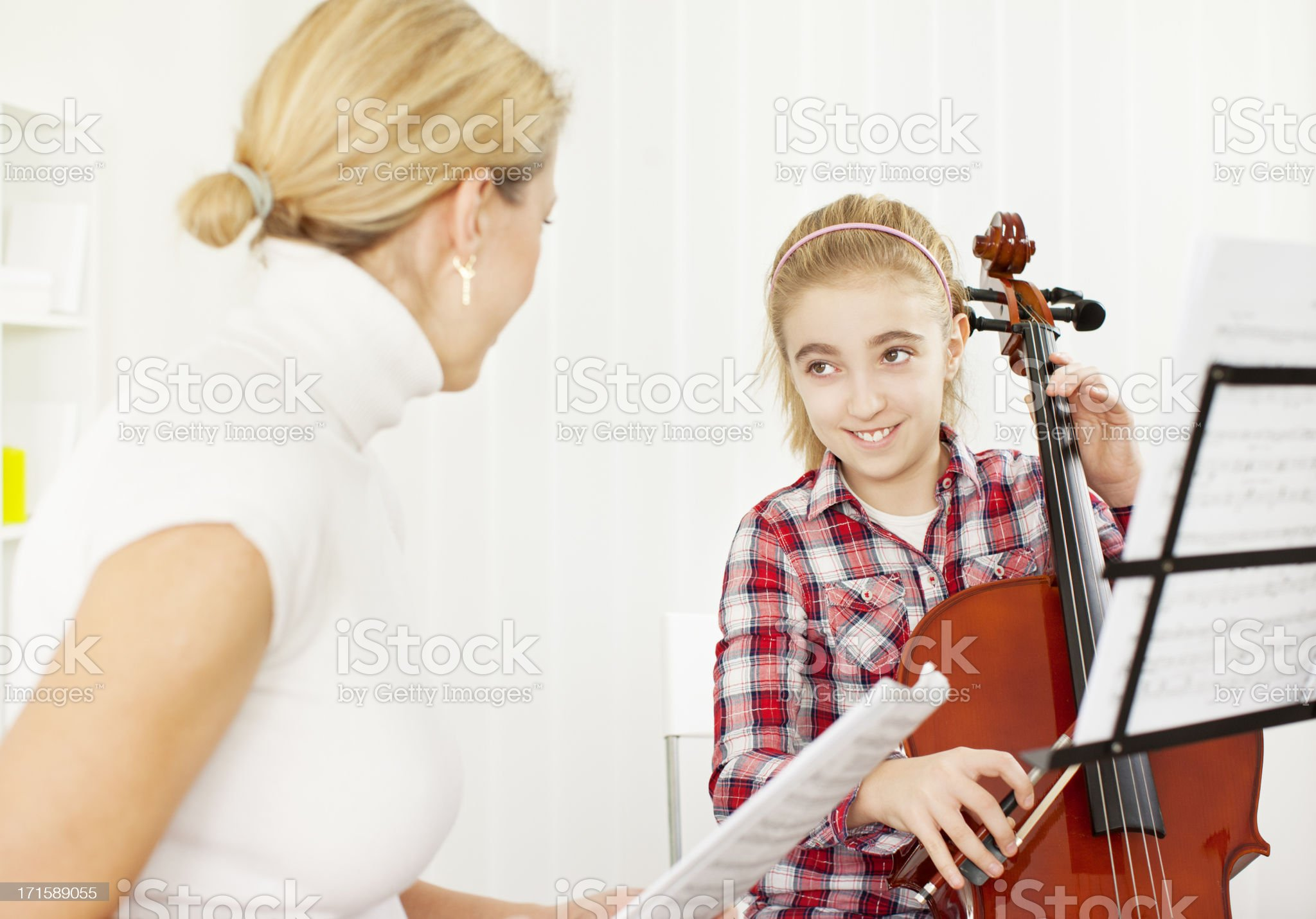 Little Girl Learning to play Cello. royalty-free stock photo