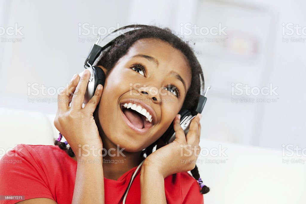 Little girl listening a music royalty-free stock photo