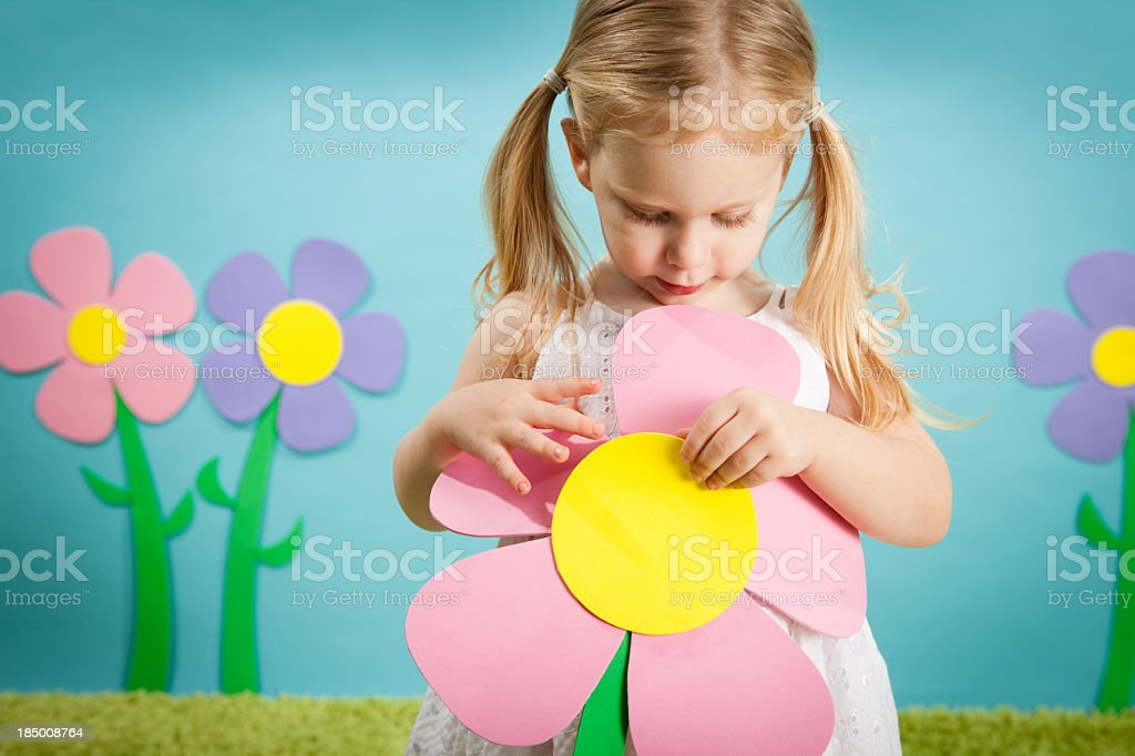 Little Girl Looking at Flower,in Whimsical, Outdoor World royalty-free stock photo