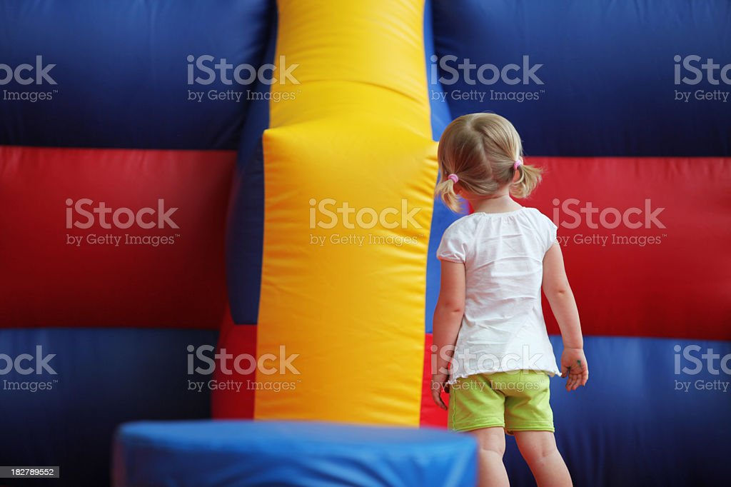 Little Girl looking at MoonBounce royalty-free stock photo