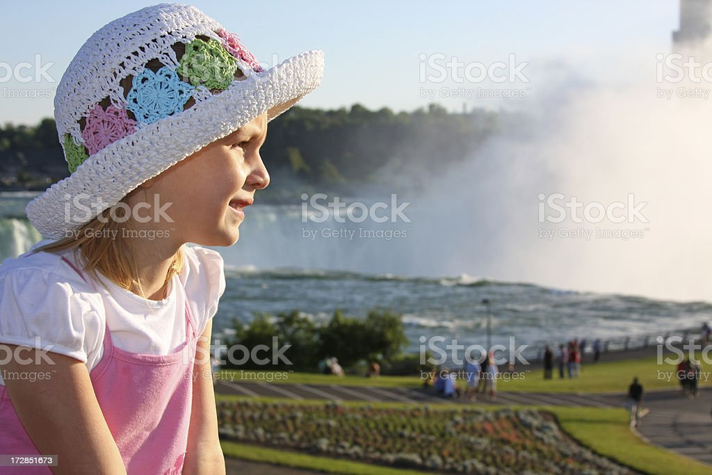 Little girl looking at Niagara Falls royalty-free stock photo