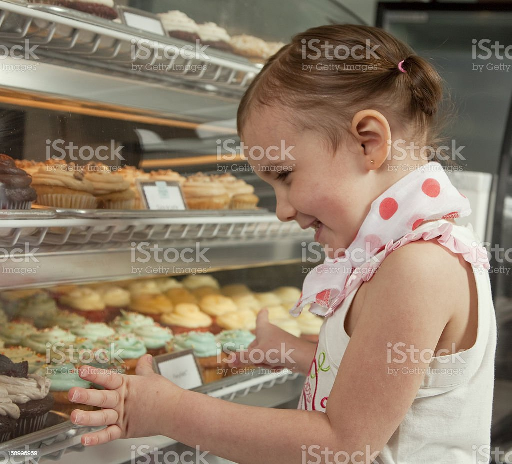 Little Girl Looking At Sweets stock photo