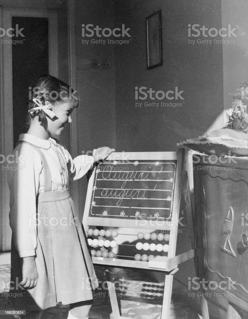 Little Girl Looking Blackboard in 1955.Black And White stock photo