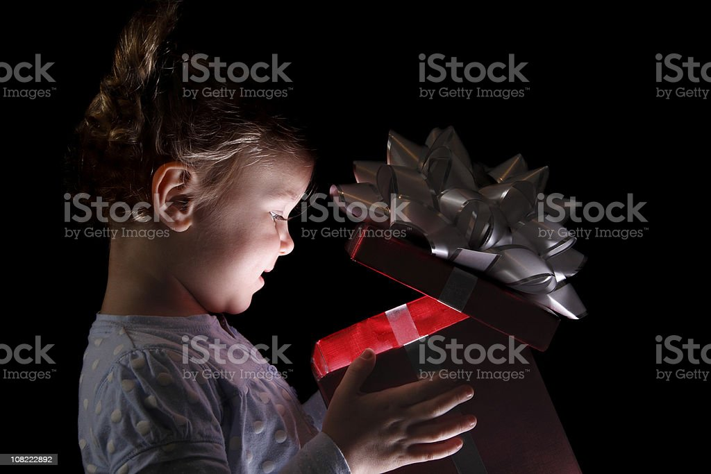 Little Girl Looking in Christmas Gift royalty-free stock photo