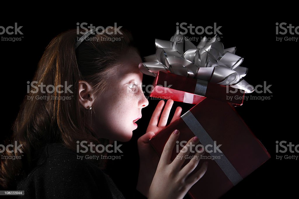Little Girl Looking in Christmas Present royalty-free stock photo