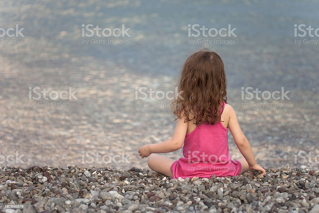 Little girl looking the sea royalty-free stock photo