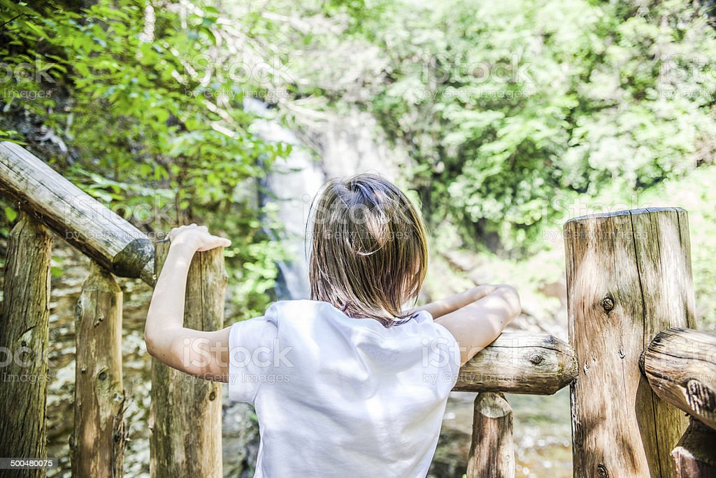 Little girl looking to the fall at Bushkill Falls park royalty-free stock photo