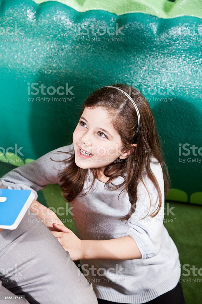 Little girl looking up at teacher stock photo