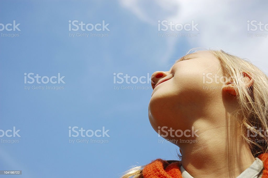 Little girl looking up in the sky royalty-free stock photo