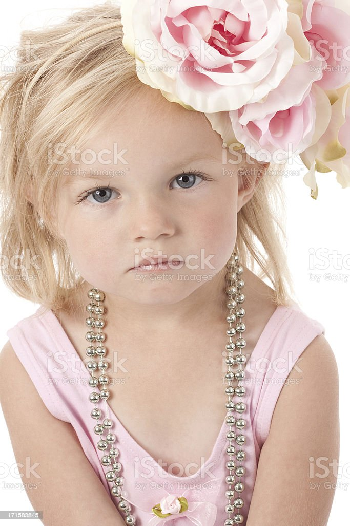 Little Girl Looking Up with Flowers in Hair royalty-free stock photo