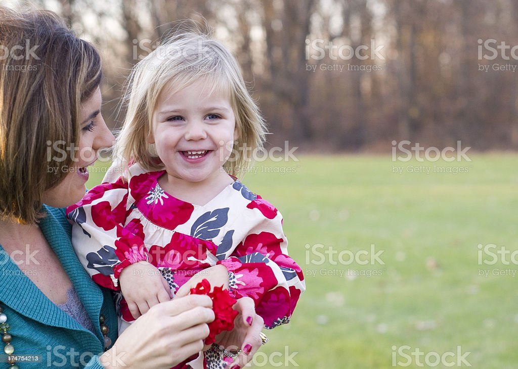 Little girl loves being held by mom royalty-free stock photo
