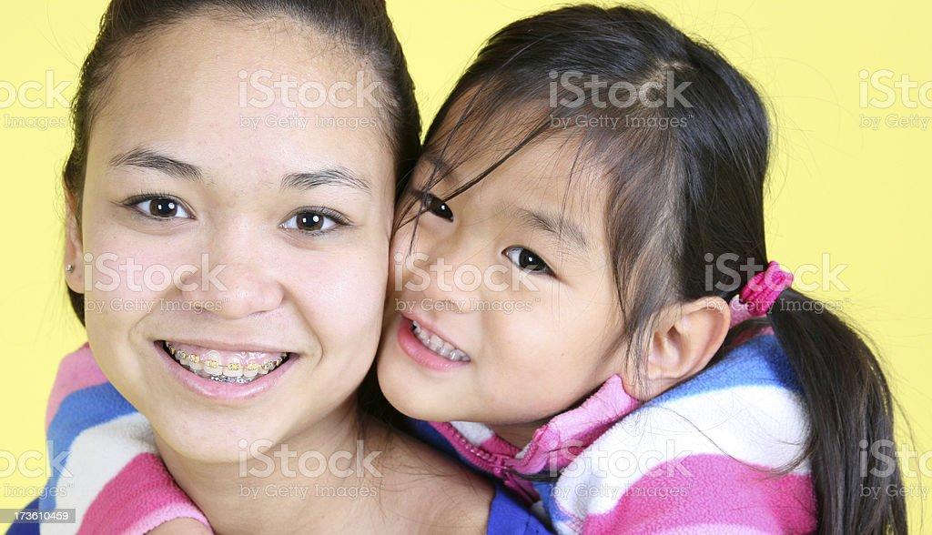 Little girl loves her big sis royalty-free stock photo