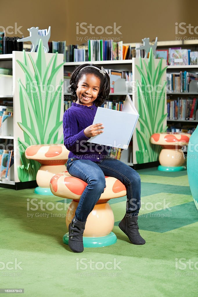 Little girl loves to read stock photo