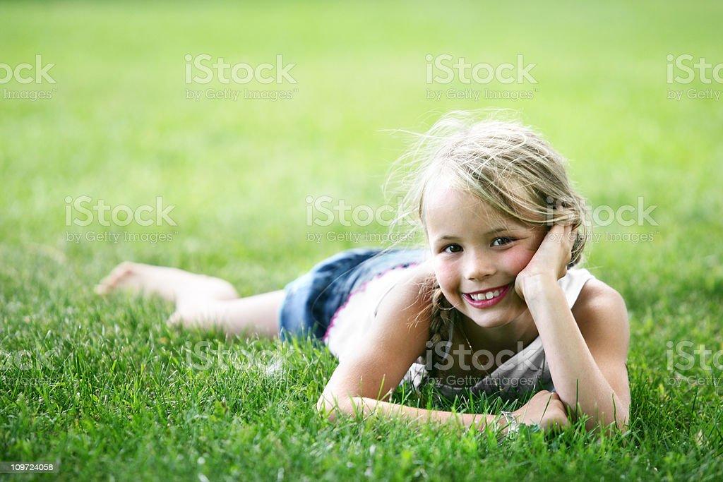 Little Girl Lying on Grass royalty-free stock photo