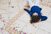 Little girl lying on the floor with confetti