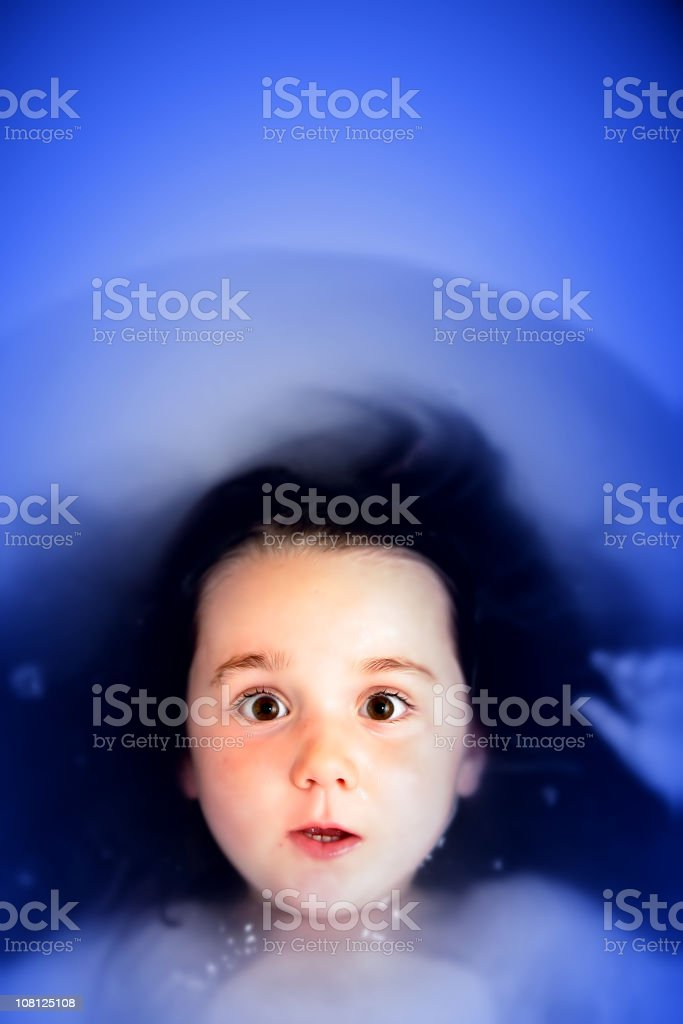 Little Girl Lying Underwater in Bathtub royalty-free stock photo