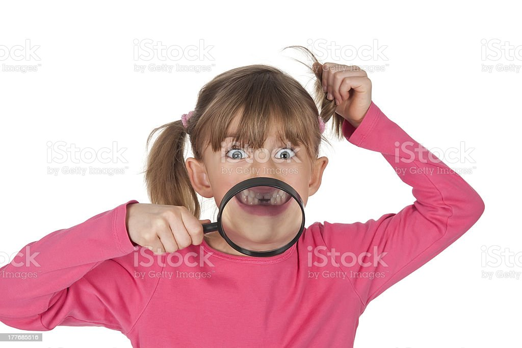 little girl magnifies tooth gap stock photo