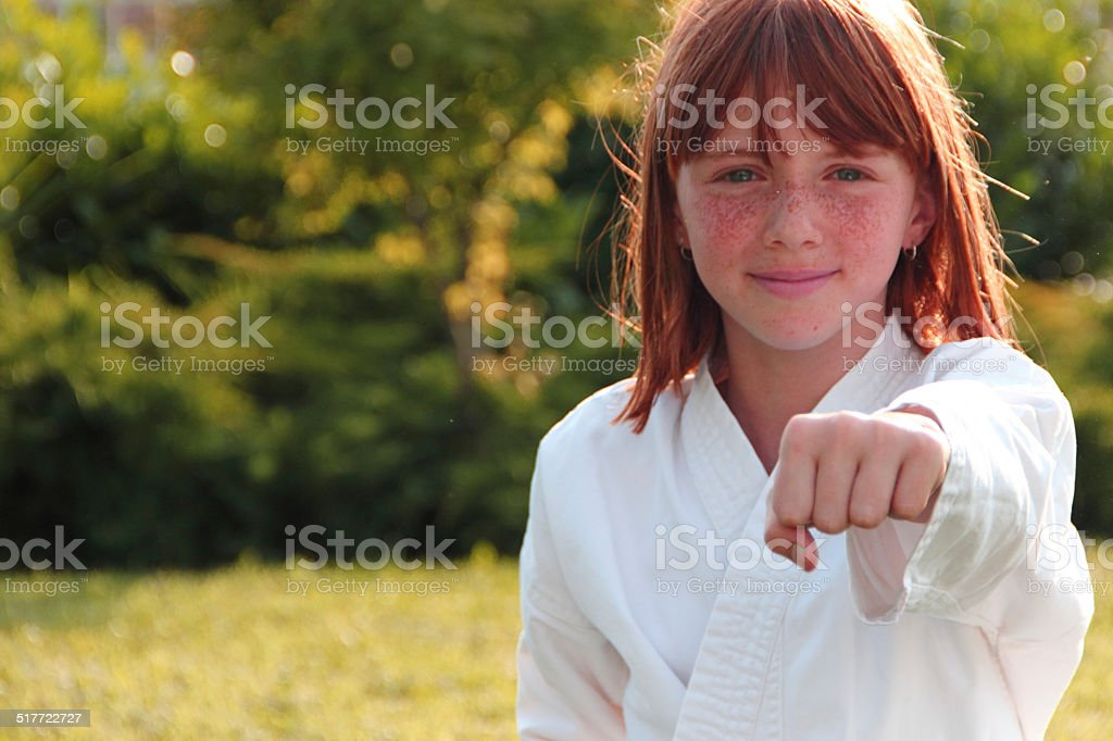 Little girl make karate exercises stock photo
