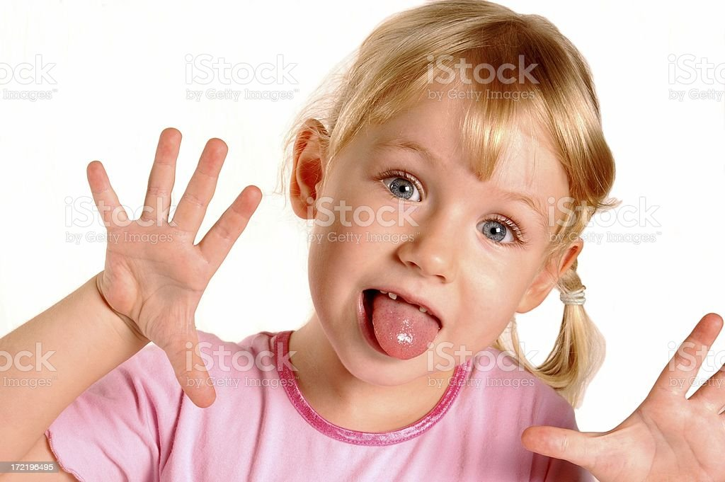 Little Girl Making a Funny Face stock photo