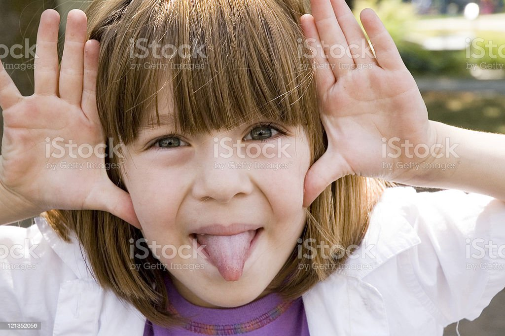 Little girl making a silly face royalty-free stock photo