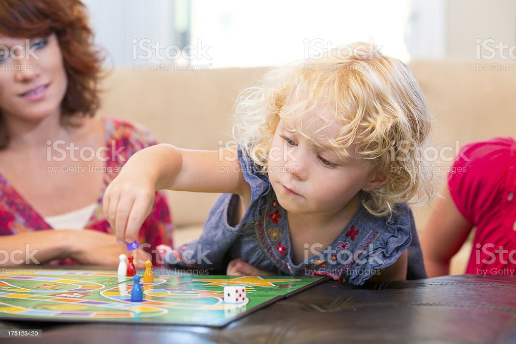 Little girl making her next board game move royalty-free stock photo