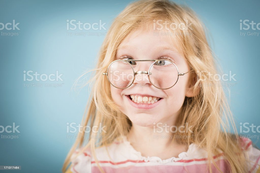 Little Girl Making Silly Face While Wearing Vintage Nerdy Glasses royalty-free stock photo