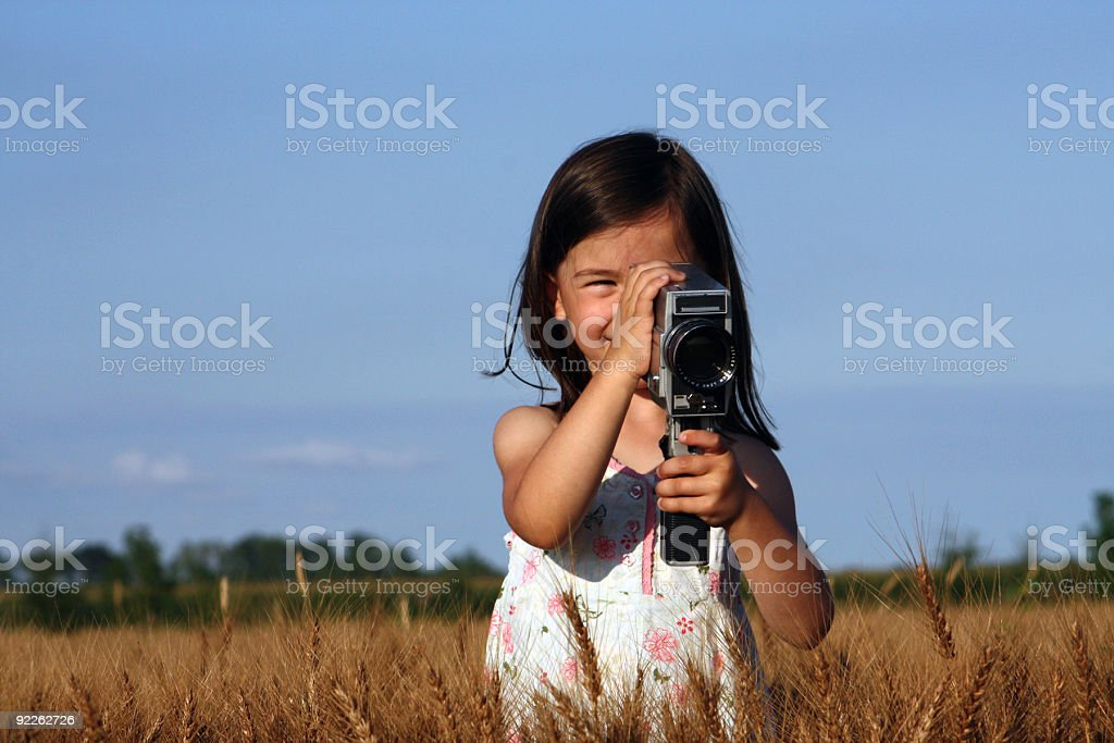 Little girl making videos in open air stock photo