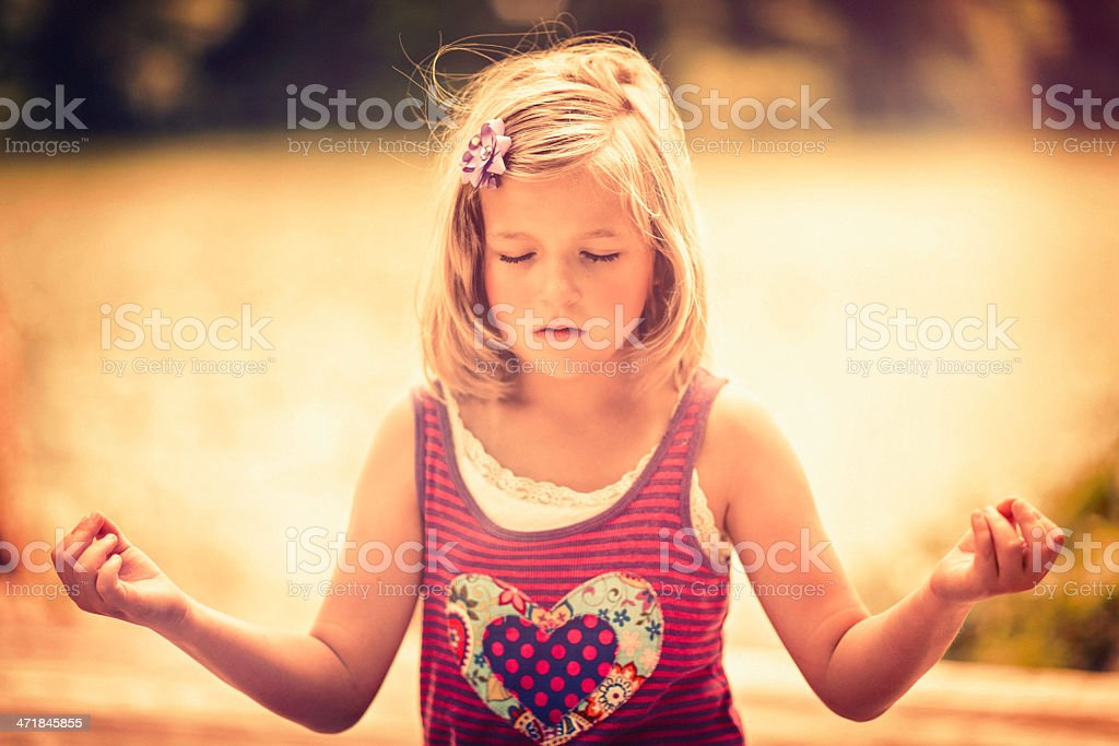 Little Girl Meditating royalty-free stock photo