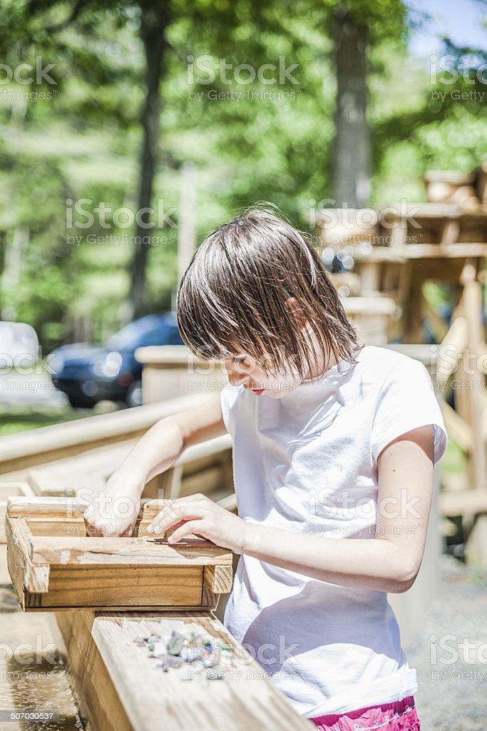 Little girl mining minerals stock photo